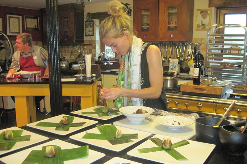 Anna preps dessert in the Novelli kitchen
