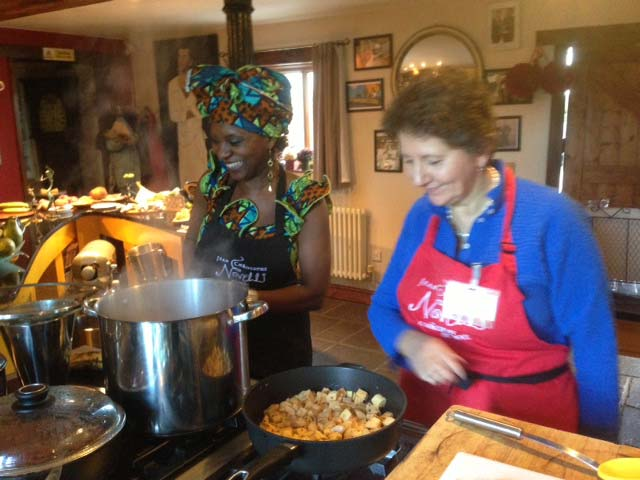 cooking up peanut butter soup and kelewele in the Novelli kitchen