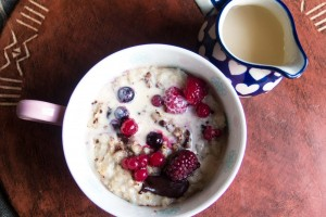 Berry and chocolate winter warming porridge with evaporated milk