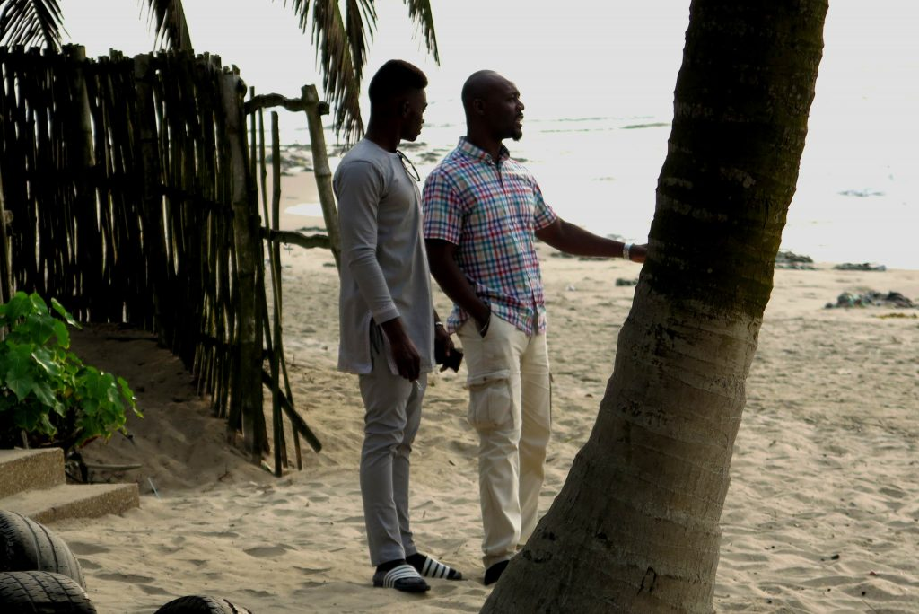 Nana Kwesi and Charles ponder the Atlantic Ocean